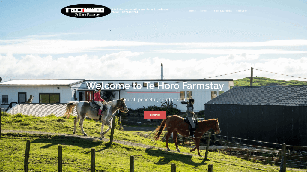 image of the website for te horo farmstay with a person riding a white horse past the milkshed homestay.
